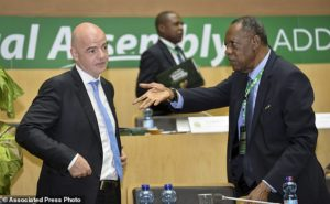Issa Hayatou, right, speaks to FIFA President Gianni Infantino, left, at the opening of the general assembly of the Confederation of African Football (CAF) in Addis Ababa, Ethiopia Thursday, March 16, 2017. Issa Hayatou was voted out as president of the African soccer confederation on Thursday after 29 years in charge, losing to challenger Ahmad of Madagascar in a major shakeup for the sport on the continent. (AP Photo)